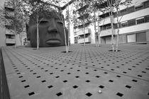 Yard with head's sculpture von michal gabriel