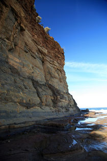 Cliff wall next to the ocean by michal gabriel