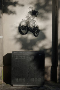 Graffitti stencil of jumping motorbike. by Tom Hanslien