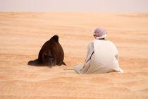Man with a camel  von sylviphotography
