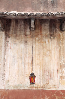 Old Lantern Hanging Against Wall