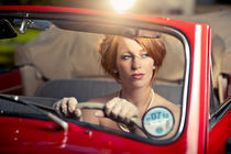 Redhead Beauty in Red Classic Car von Paul Dakeyne