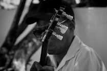 Street musician by Alvaro Chahin