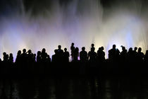 People silhouettes in front of the fountain by Tanja Krstevska