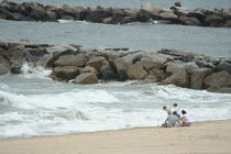 Family on the beach by Kristin Scott