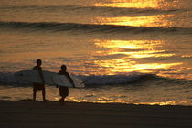 Two surfers at sunrise by Kristin Scott