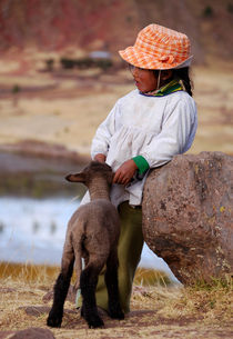 Sillustani Girl with hat and lamb by RicardMN Photography