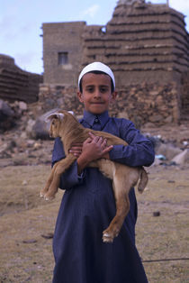 Local Boy (Yasir) with Pet Lamb by Wolfgang Kaehler