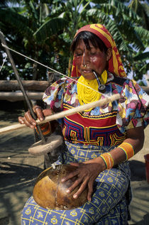 Kuna Indian Woman Using Primitive Drill by Wolfgang Kaehler
