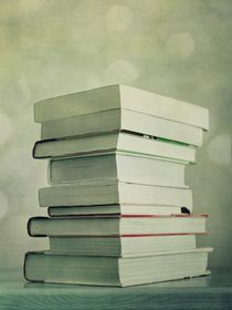 piled reading matter by Priska  Wettstein