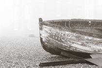 boat in fog on pebble beach - sepia by Claudia Gannon