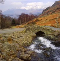 Winter view of Ashness Packhorse Bridge looking over Derwent Water to Skiddaw by Mark Lucock