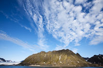 Clouds above steep cliffs along Spitsbergen Island in Albert I Land on summer evening by Danita Delimont