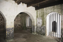 Interior of slave holding cell at Cape Coast Castle by Danita Delimont