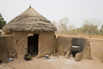Traditional thached mud dwelling by Danita Delimont
