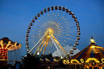 Lighted Ferris Wheel and other Rides after dark on Navy Pier by Danita Delimont