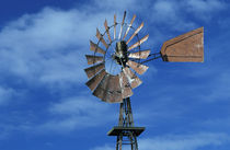 Windmill against blue sky by Danita Delimont