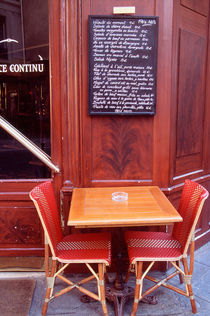 Two chairs in front of a Parisian bistro by Danita Delimont