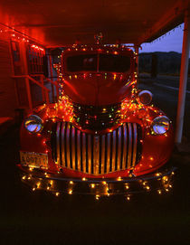 Vintage fire truck decorated with lights at Christmas by Danita Delimont