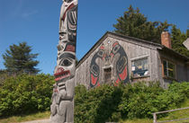 Totem pole and tourist shop by Danita Delimont