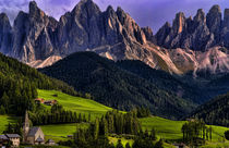 Beautiful isolated lonely church St Maddalena and village in valley in the Italian Dolomites village of Val Di Funes mountains Alpine area of Italy with Dolomites looming behind von Danita Delimont