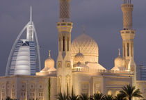 Mosque in evening with Burj al Arab Hotel in background by Danita Delimont