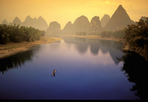 Lone fisherman works calm waters of the Li River von Danita Delimont