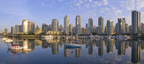 Looking across False Creek at the skyline of Vancouver British Columbia at sunrise by Danita Delimont