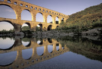 Roman aqueduct and bridge; sunset light von Danita Delimont