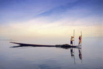 (Myanmar) Fishing boat reflected on Inle Lake by Danita Delimont