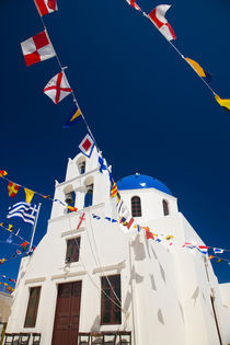 Greece and Greek Island of Santorini town of Oia Blue Domed Church with flags flying von Danita Delimont