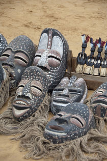 Typical wooden masks & voodoo dolls used in rituals by Danita Delimont