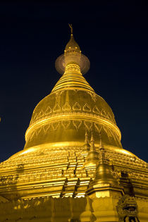 Buddhist temple in Yangon at night by Danita Delimont