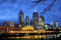 A nighttime view of the lights and buildings around the river running through downtown Melbourne by Danita Delimont