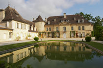 The main chateau building with its tower and a pond showing a reflection Chateau Bouscaut Cru Classe Cadaujac Graves Pessac Leognan Bordeaux Gironde Aquitaine France by Danita Delimont