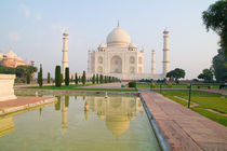 The quiet peaceful Taj Mahal at sunrise one of the wonders of the world in Agra India by Danita Delimont