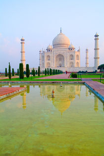 The quiet peaceful World Famous Taj Mahal at sunrise with reflrection one of the wonders of the world in Agra India von Danita Delimont