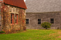 Old stone building and wooden barn in fall in rural New England von Danita Delimont