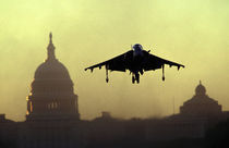A Harrier jet landing on the Mall at dawn with the US Capitol in the background by Danita Delimont