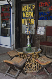 Cappadocia; sidewalk cafe table with Turkish water pipe and folding stools by Danita Delimont