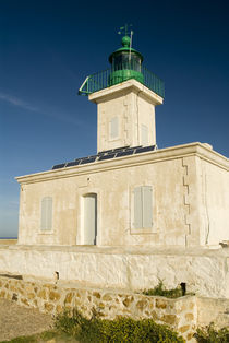 Lighthouse with solar panels short hike from town von Danita Delimont