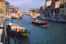 Boats bringing in supplies by way of Venice canal by Danita Delimont