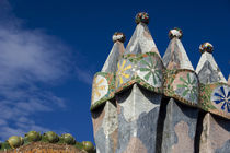 Views of typical Gaudi chimney sturctures covered in colorful broken pottery tiles called trencadis by Danita Delimont