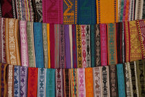 Woven belts on display at market by Danita Delimont
