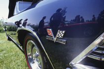 Reflection of 1997 Chevrolet Stingray in 1969 Chevrolet Malibu convertible von Danita Delimont