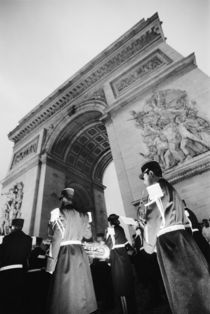 Military ceremony at the Arc de Triomphe by Danita Delimont