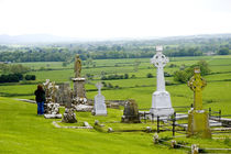 The dramatic Spectacle of the Rock of Cashel and it's gravesites by Danita Delimont