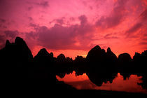Beautiful color at sunset of limestone mountains in Guilin by Danita Delimont