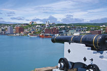 John's as seen from near a cannon at Fort Cabot on Signal Hill across the harbor by Danita Delimont