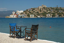 Kastellorizo: chairs on the edge of Kastellorizo harbour by Danita Delimont